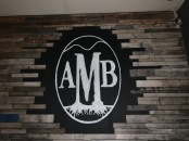 A painted Appalachian Mountain Brewery logo