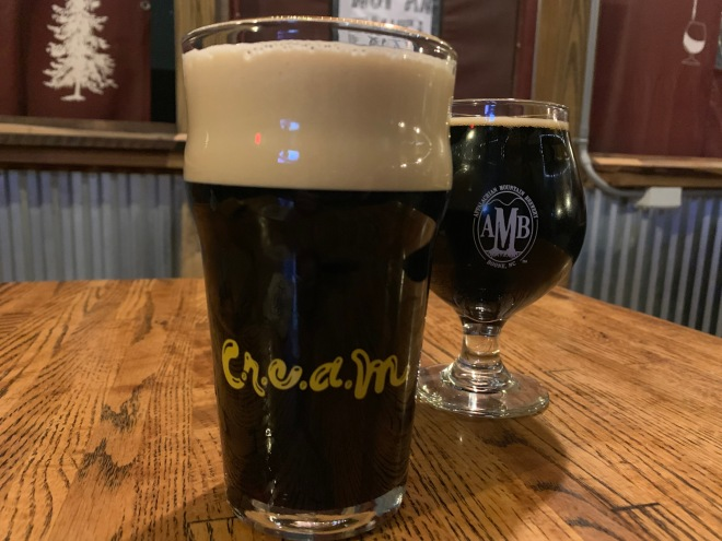 Two pints of beer on a table at Appalachian Mountain Brewery