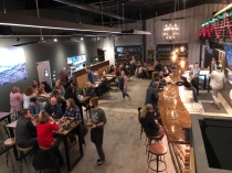 Crowded tables and bar at Booneshine Brewing Co