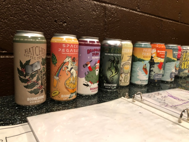 Empty cans of beer line the wall at Booneshine