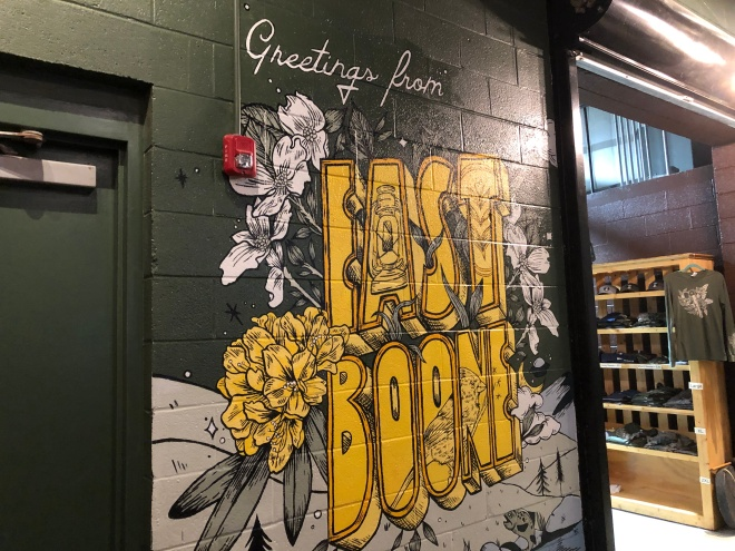"""A mural on the wall reads """"Greetings from East Boone"""""""